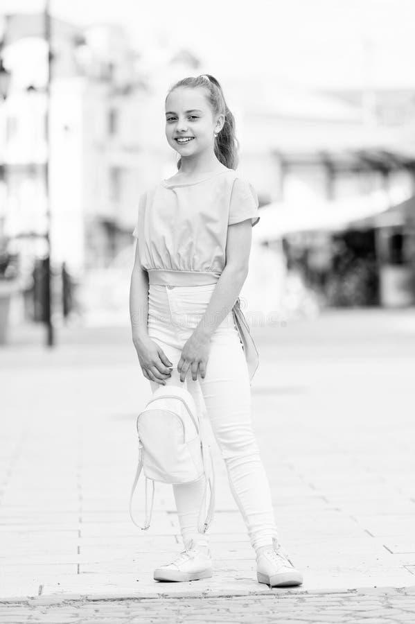 Kid long hair enjoy walk sunny day. Summer holidays. Charming stylish fashionable girl. Little child enjoy walk. Happy royalty free stock photography