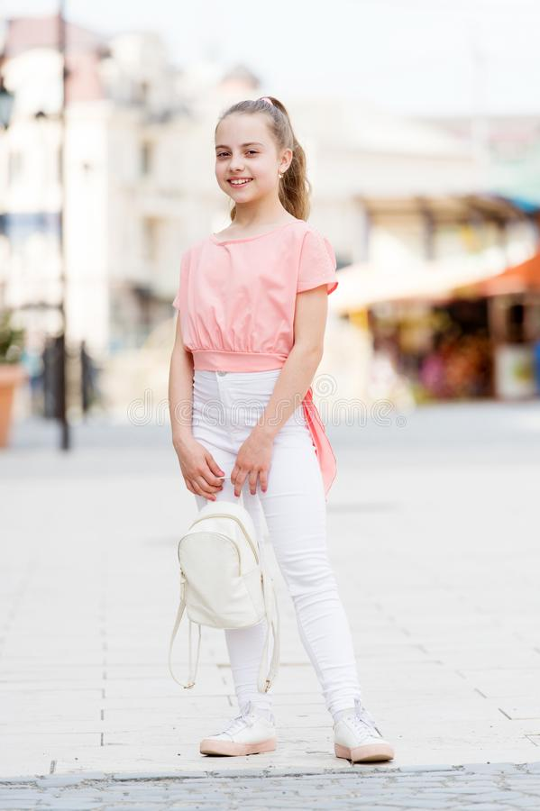 Kid long hair enjoy walk sunny day. Summer holidays. Charming stylish fashionable girl. Little child enjoy walk. Happy. Day. Enjoy being teen. Weekend walk stock photo