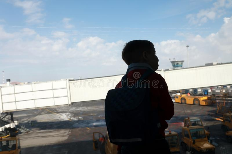 Kid looking at loading of aircraft stock images