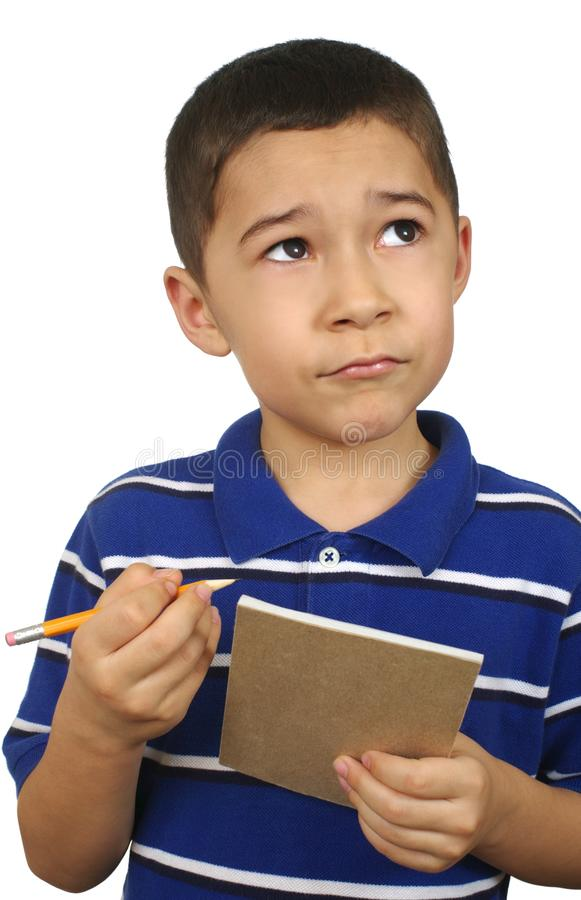Kid looking up with notebook royalty free stock photo