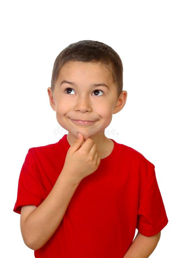 Kid looking up thinking royalty free stock photo