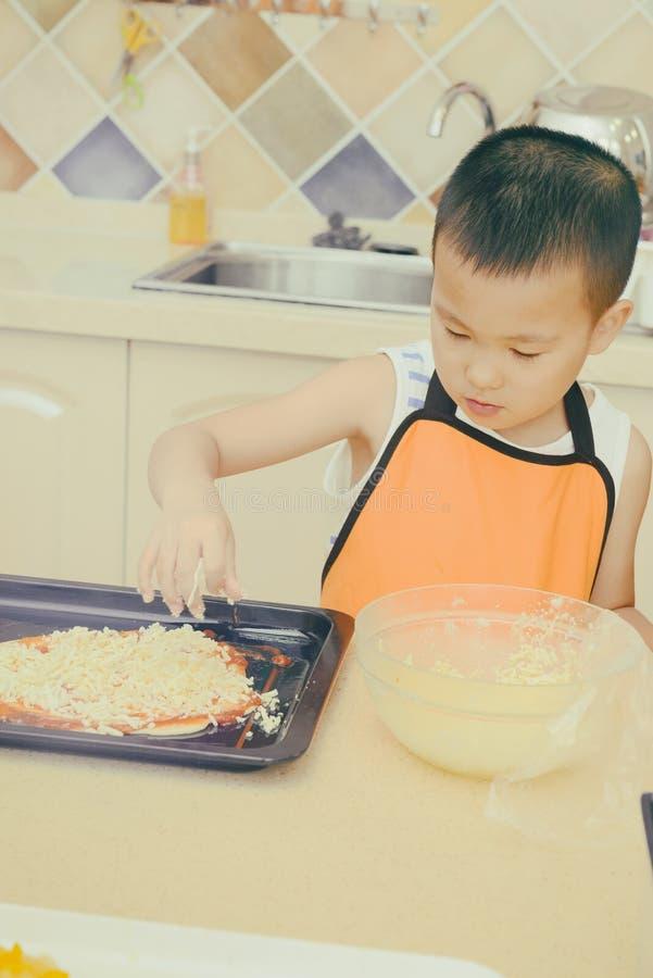 Kid making pizza stock photos