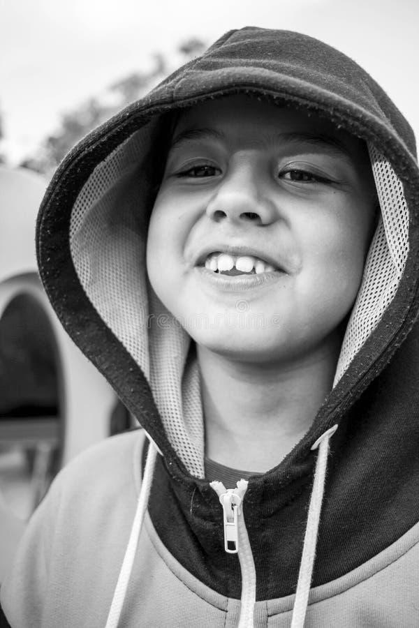 Kid making strange facial expressions stock image