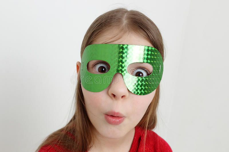 Kid and mask royalty free stock photography
