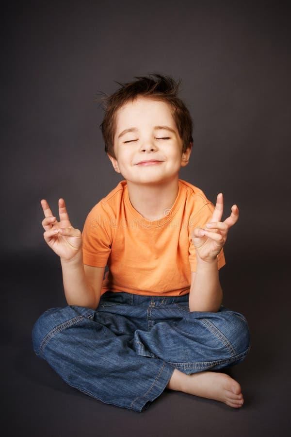 Kid In Meditation Royalty Free Stock Photos