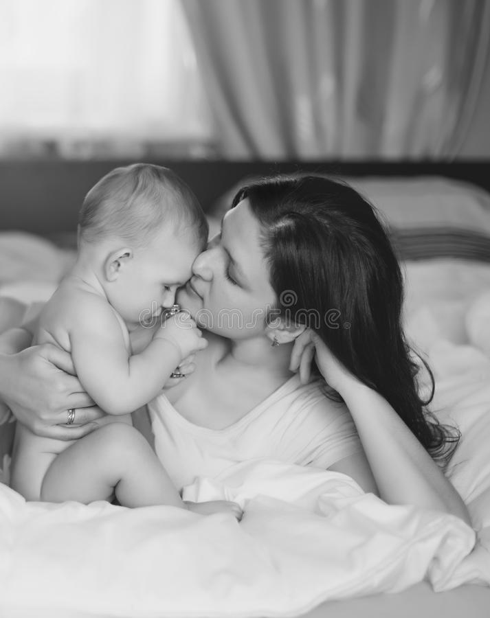 Download The Kid And Mother Gently Embrace Focus On Mother Stock Photo - Image: 27461480
