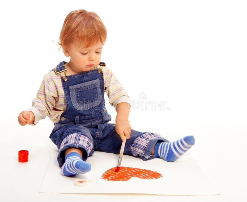 Kid paint heart on paper
