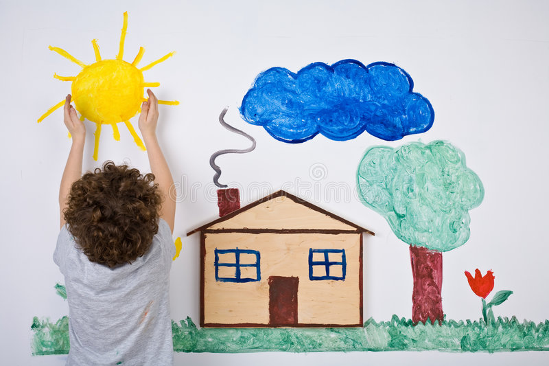 Kid painting. Young boy painting on wall