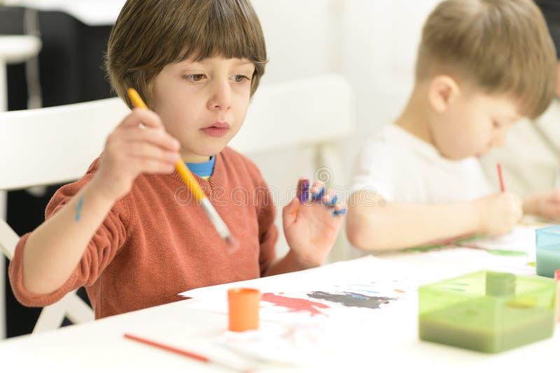 Kid Painting at Kindergarten royalty free stock image