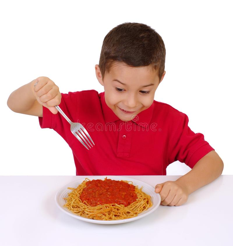 Kid and pasta royalty free stock photography