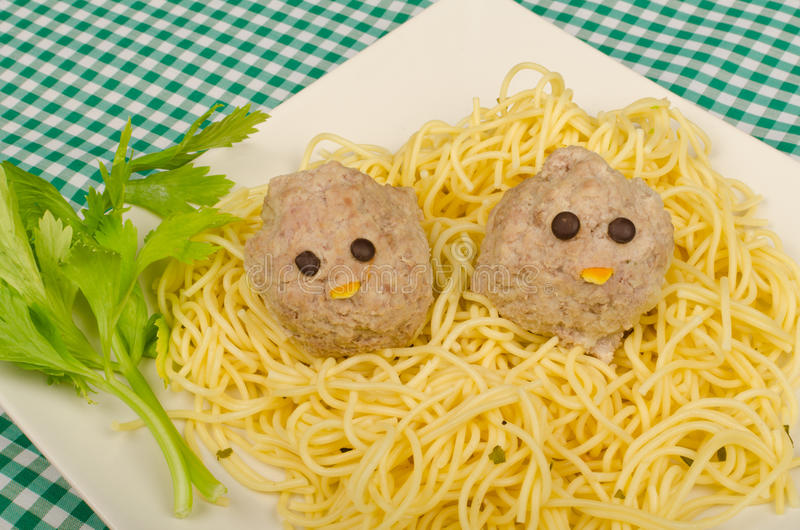 Kid pasta. A serving of pasta with a funny decoration for kids stock images