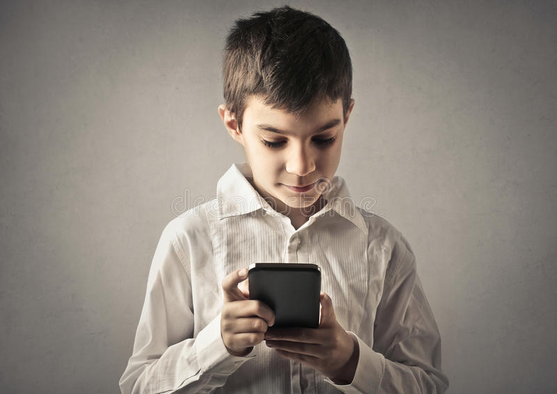 Kid with phone stock images