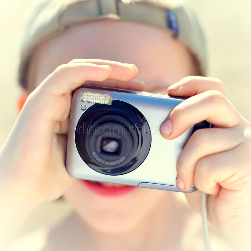 Kid with a Photo camera. Toned photo of the Kid with Photo camera outdoor stock photography