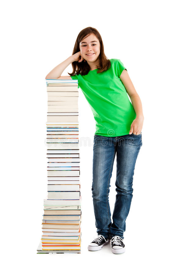 Kid and pile of books. Young girl standing next to pile of books on white background stock photography