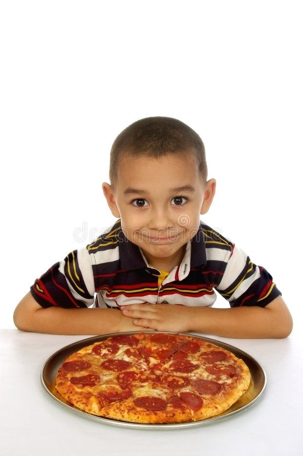 Kid and pizza royalty free stock images