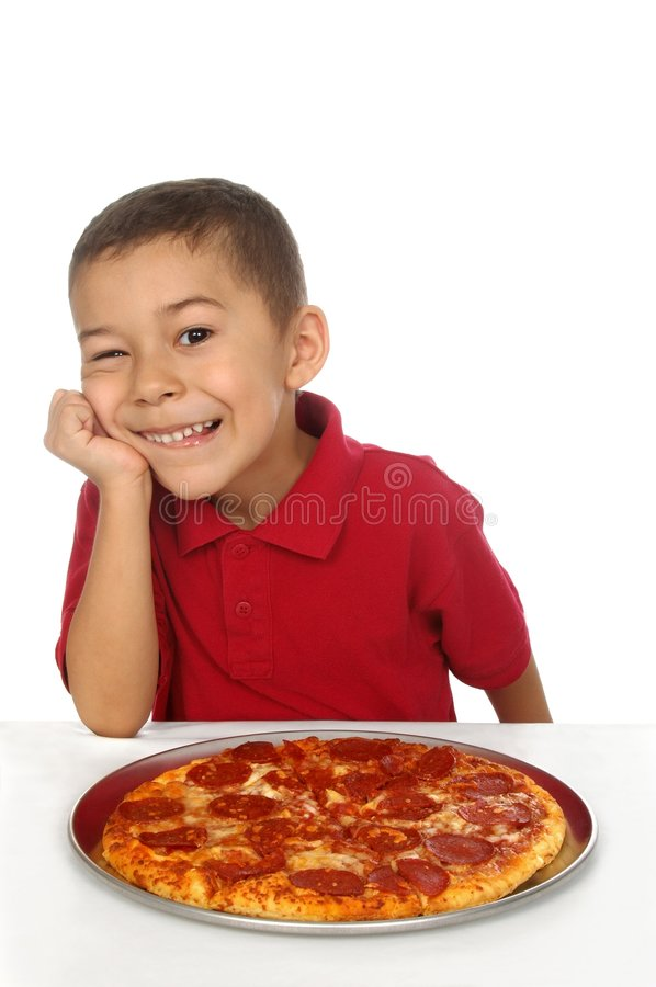 Kid and pizza. Hispanic boy ready to eat a pepperoni pizza stock photos