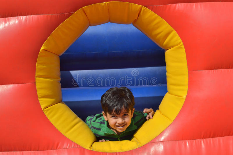 Kid is at play area. I clicked this photo during my visit at Hyderabad. Yatharth was enjoying his rides at NRT garden. Big balloon game have different color like royalty free stock image
