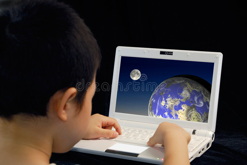 Kid play computer. Kid learning on personal computer royalty free stock photos