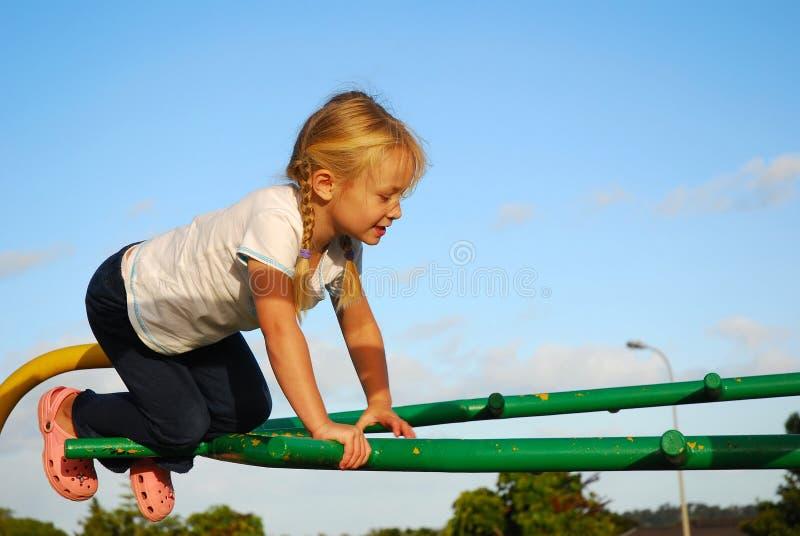 Kid on playground stock images