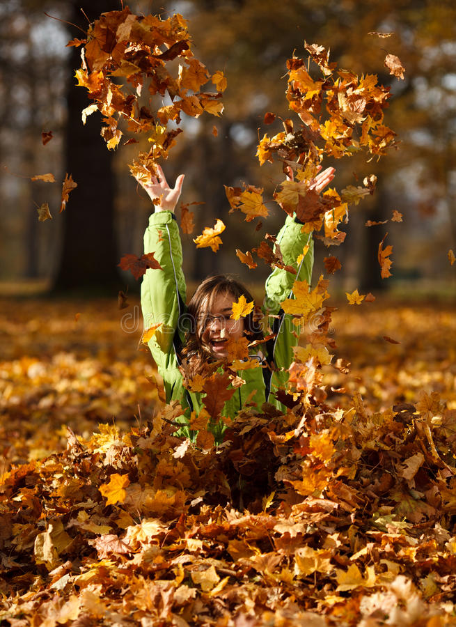 Kid playing in autumn park stock photos