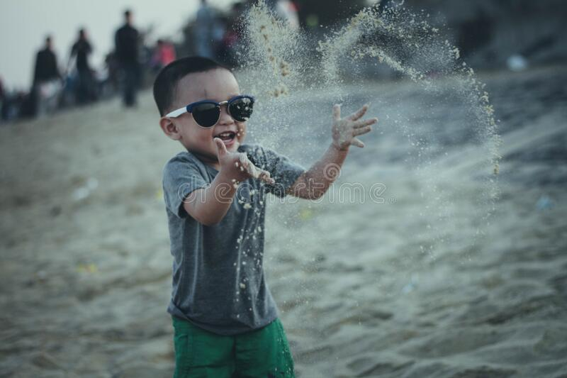 Kid playing at beach royalty free stock photography