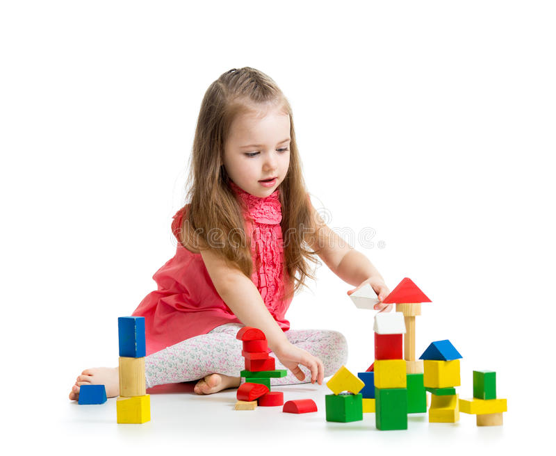 Kid playing with block toys stock image
