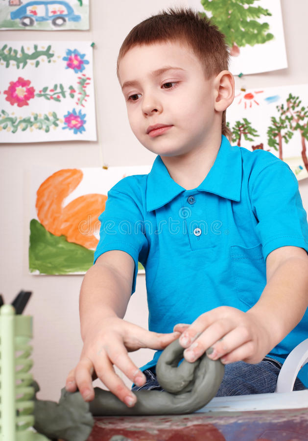 Download Kid playing with clay. stock photo. Image of indoor, earthenware - 15471912