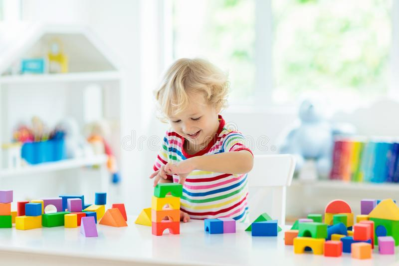Kids toys. Child building tower of toy blocks royalty free stock image