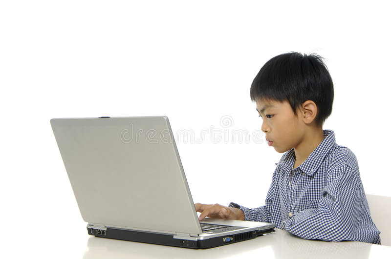 Kid playing computer. Games or learning online royalty free stock photo