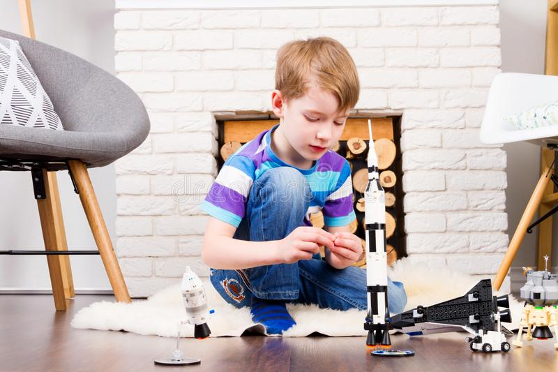 Kid playing with constructor at home stock photo