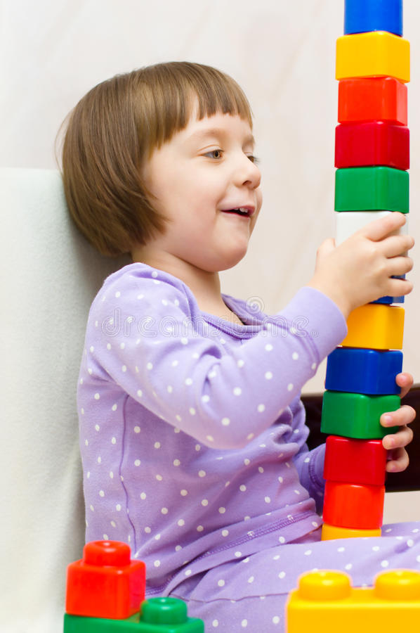 Download Kid playing stock photo. Image of cube, plastic, education - 35278236