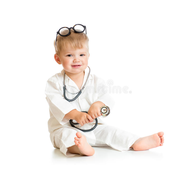 Kid playing doctor with stethoscope and eyeglasses stock images
