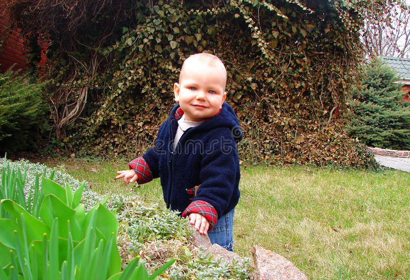 Download The Kid Playing In The Garden Stock Image - Image: 20731345