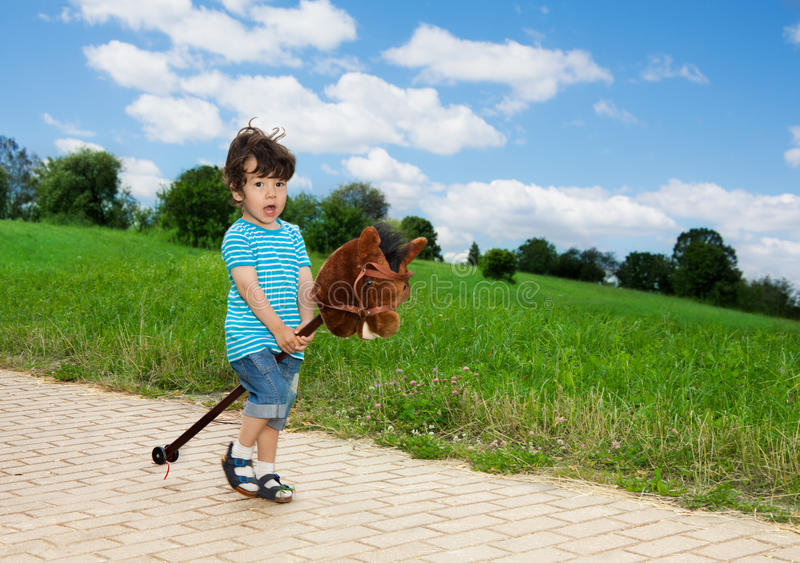 Download Kid Playing With Horse Stick Stock Image - Image: 26319335