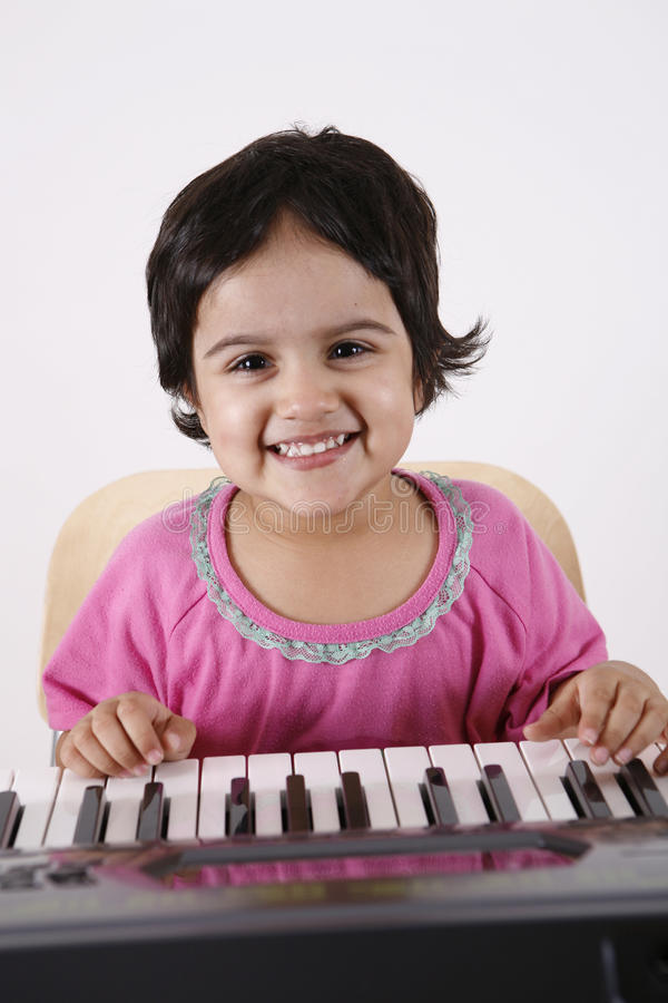 Download Kid playing a keyboard stock photo. Image of learn, electronic - 12406914