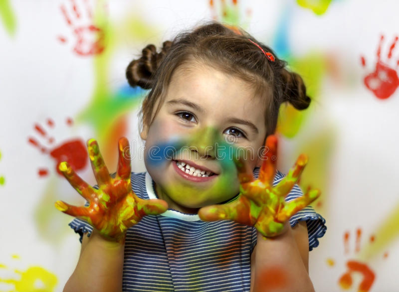 Kid playing with paint stock photography