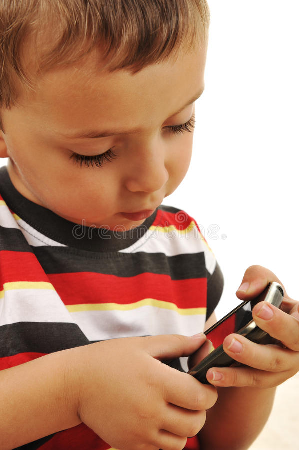 Kid Playing With Touch Mobile Royalty Free Stock Image