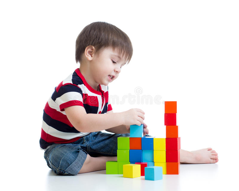 Kid playing toy blocks isolated royalty free stock images