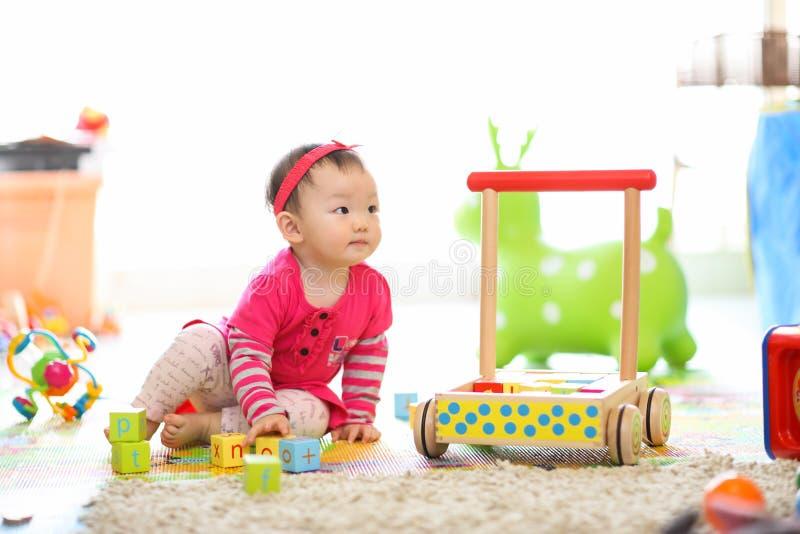 Kid playing toys stock photos