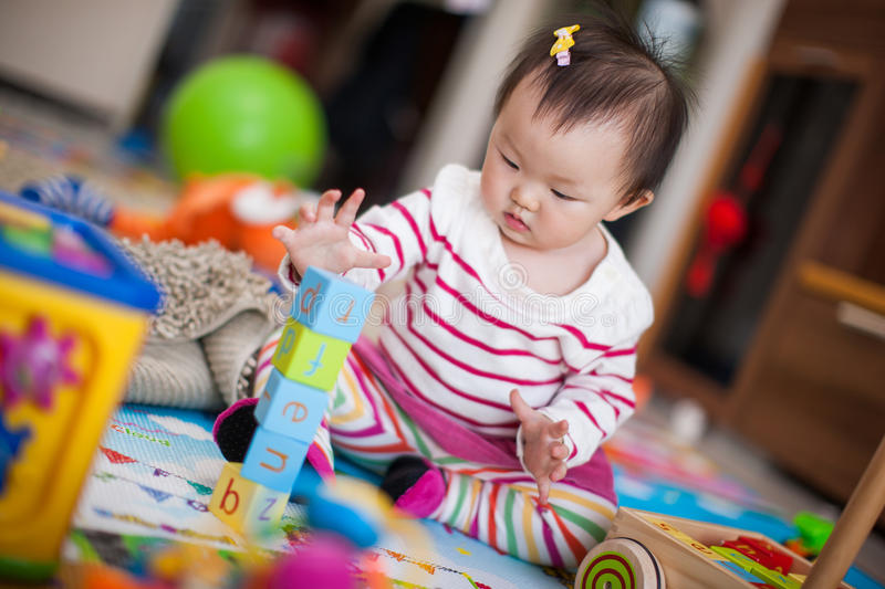 Kid playing toys stock photo