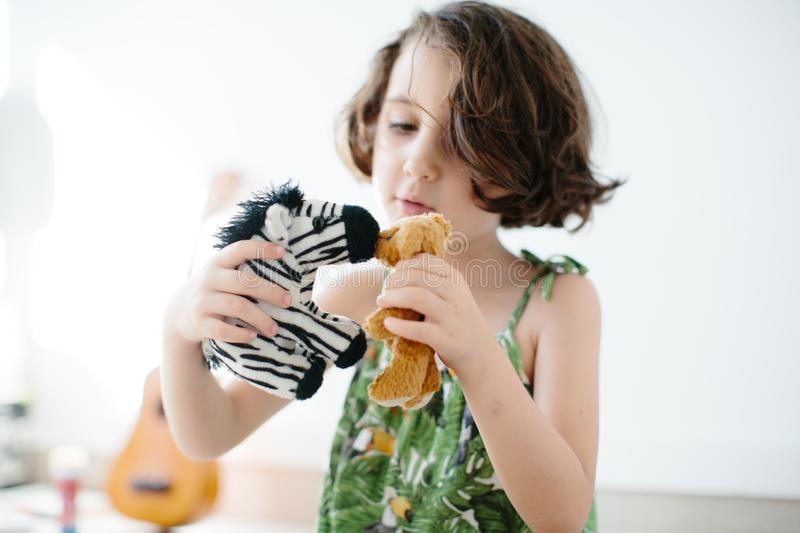 Kid playing with toys indoors stock photo