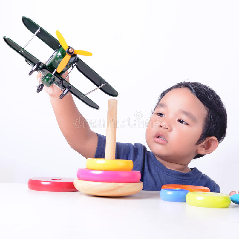 Kid playing with toys stock images