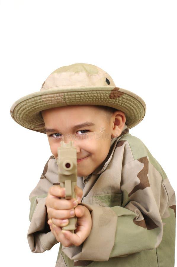 Kid pointing a gun at you stock image