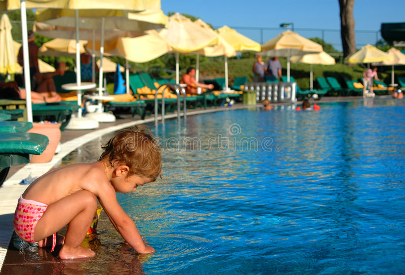 Kid & pool stock images
