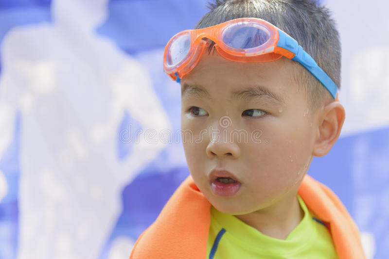 Kid portrait after swim. Chinese kid portrait after swim dressing up swimsuit in summer stock image