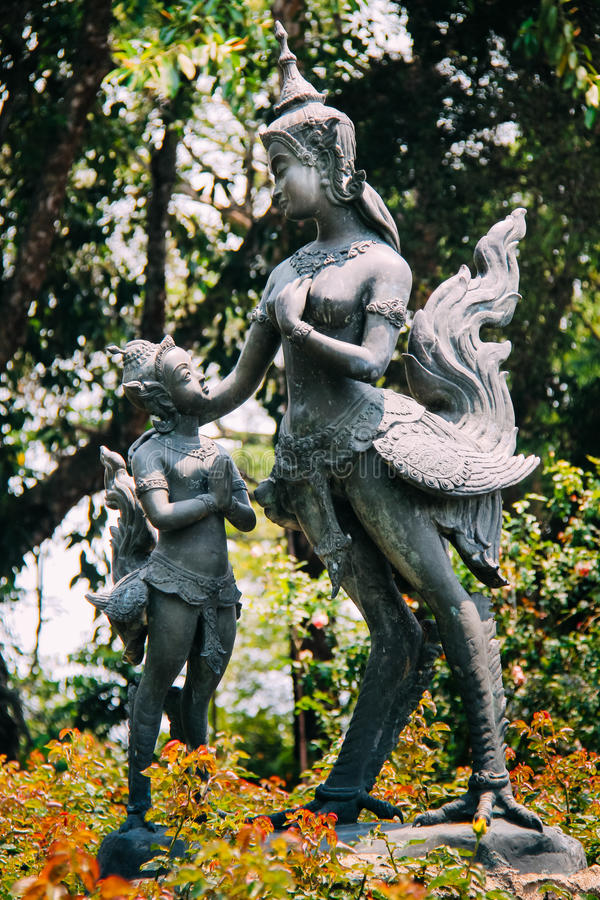 Kid Praying to Woman Statue looks alike Myth Giant Bird. Kid Praying to Woman Statue which looks alike Myth Giant Bird God royalty free stock photos