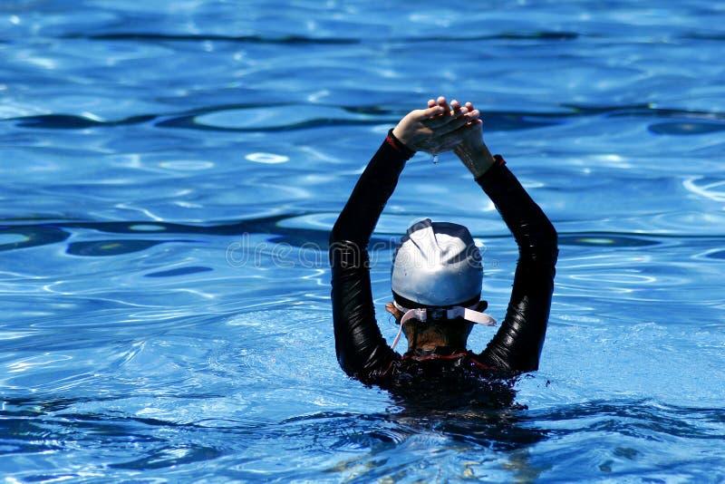 Kid prepares to swim in a swimming pool. stock photos
