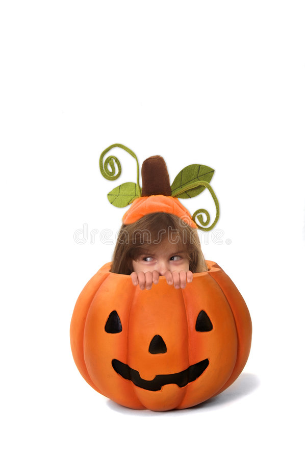 Kid in a Pumpkin royalty free stock photography