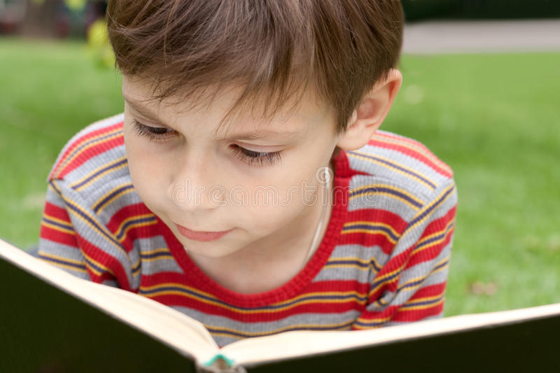 Kid reading a book stock image