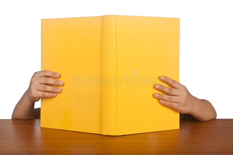 Kid reading a book stock images